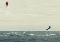 man kite surfing in air